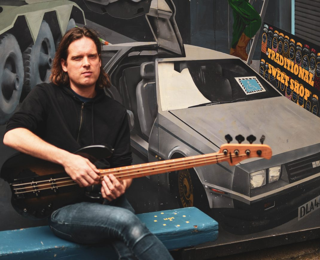 Mark Hamilton from Ash with his Ruach Skellig Bass Guitar Delorean